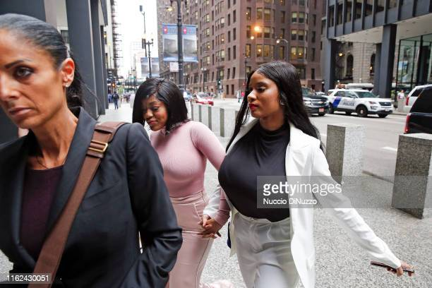 Supporters of singer R. Kelly, Joycelyn Savage and Azriel Clary arrive for the singer's arraignment at the Dirksen Federal Building on July 16, 2019...