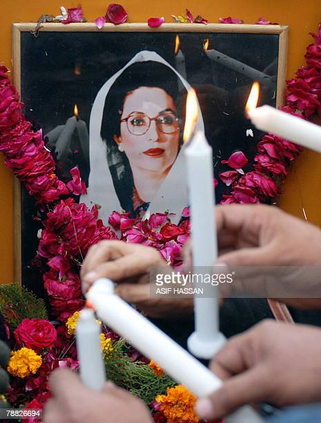 Supporters of slain Pakistani opposition leader Benazir Bhutto light candles to pay tribute to their leader during a rally in Karachi 08 January 2008...