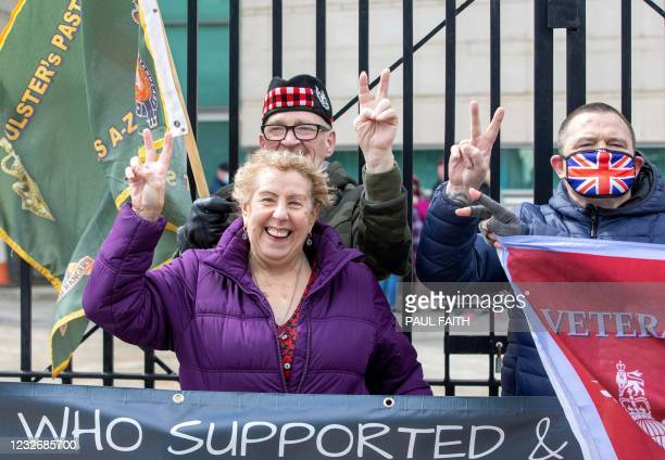 Supporters of Soldier A and Soldier C react after the case against the two former paratroopers collapsed at the High Court in Belfast on May 4, 2021....