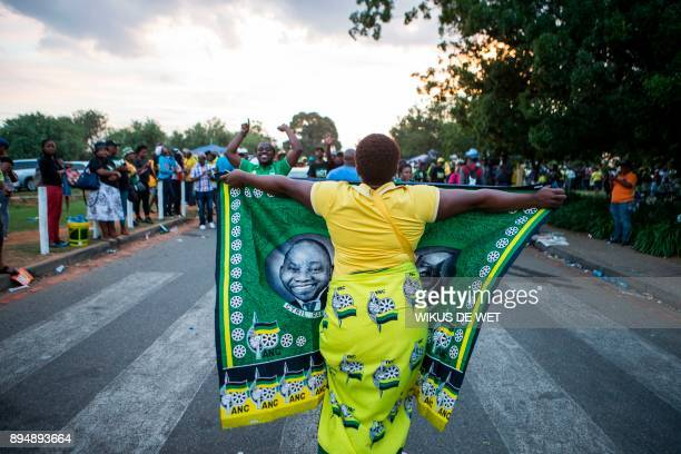 Supporters of South African deputy president Cyril Ramaphosa celebrate after he was announced President of the African National Congress party on...