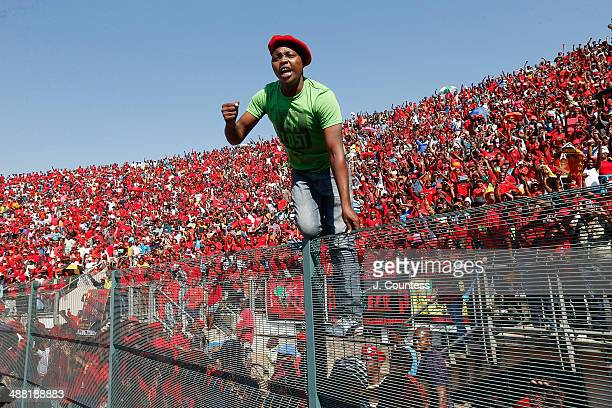 Supporters of South African presidential candidate Julius Malema cheer as he greets fans during an Economic Freedom Fighters presidential campaign...