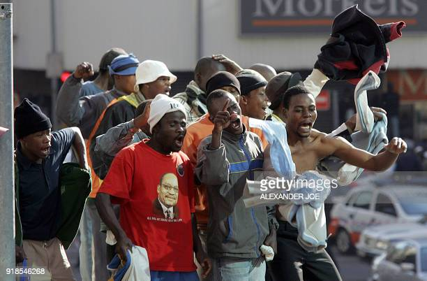Supporters of South Africa's Former deputy president Jacob Zuma celebrate after he was acquitted of rape in Johannesburg 08 May 2006 Zuma was...