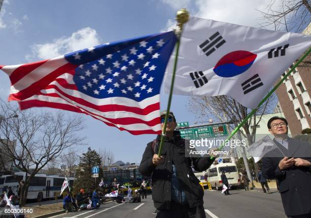 Supporters of South Korean President, Park Geun-hye take part in a rally in front of the Korean Constitutional Court before the impeachment verdict...