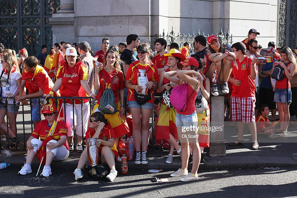 Supporters of Spain's national football team prepare to congratulate their team's players as they return to Madrid following their victory in Euro 2012 football championships on July 2, 2012 in Madrid, Spain. Spain beat Italy 4-0 in the UEFA EURO 2012 final match in Kiev, Ukraine, on July 1, 2012.