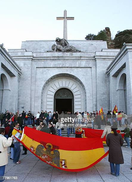 Supporters of Spanish dictator Francisco Franco unfurl the Spanish banner under Franco bearing the Eagle of St John 17 November 2007 in front of the...