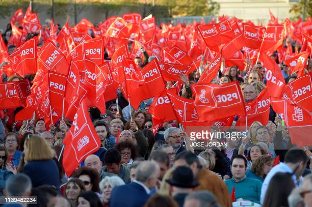 Supporters of Spanish Socialist Party wave flags as they wait for the start of their last campaign rally in Valencia on April 26 2019 ahead of the...