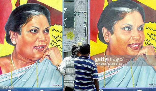 Supporters of Sri Lanka's Freedom Alliance party erect posters of party and Sri Lankan President Chandrika Kumaratunga at Wellawette on the outskirts...