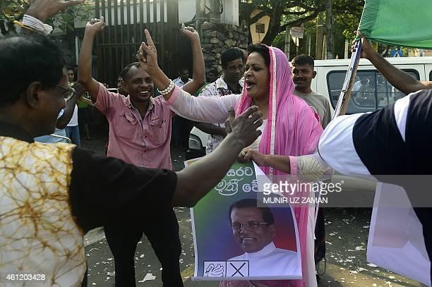 Supporters of Sri Lanka's main opposition candidate Maithripala Sirisena celebrate in the streets of Colombo after Sri Lanka's President Mahinda...