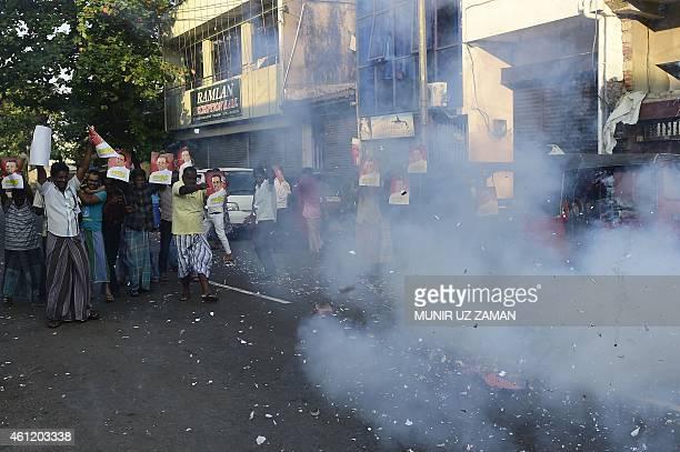 Supporters of Sri Lanka's Maithripala Sirisena set off firecrackers as they celebrate in the streets of Colombo after Sri Lanka's President Mahinda...