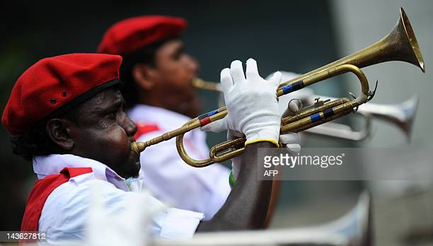Supporters of Sri Lanka's Marxist JVP party plays the trumpet during the annual May Day parade in Colombo on May 1,2012. The main JVP which once...