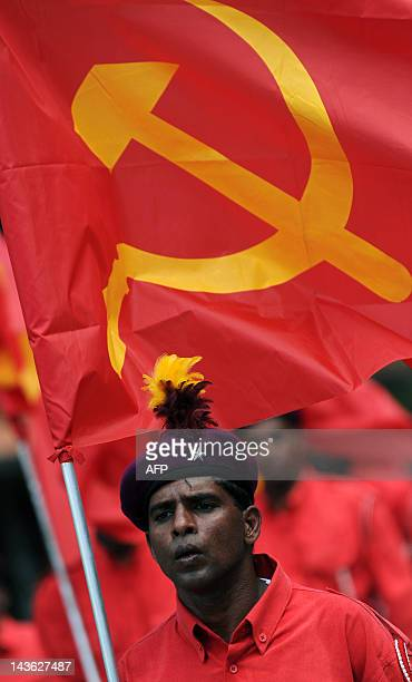 Supporters of Sri Lanka's Marxist JVP party wave communist flags during the annual May Day parade in Colombo on May 1,2012. The main JVP which once...