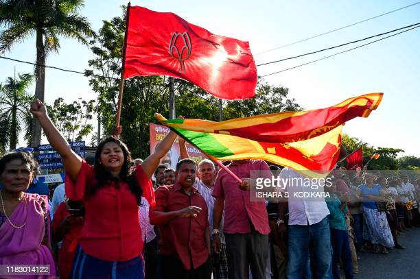 Supporters of Sri Lanka's Presidentelect Gotabaya Rajapaksa cheer near the election commission office in Colombo on November 17 2019 Gotabaya...