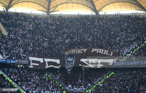 Supporters of St Pauli cheer during the Second Bundesliga match between Hamburger SV and FC St Pauli at Volksparkstadion on September 30 2018 in...