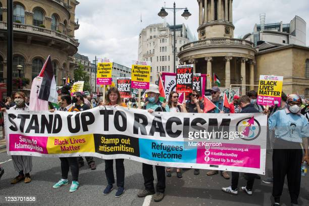 Supporters of Stand Up To Racism join thousands of people attending a United Against The Tories national demonstration organised by the People's...