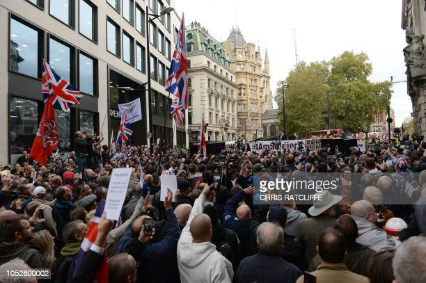 Supporters of Stephen Yaxley-Lennon, AKA Tommy Robinson, founder and former leader of the anti-Islam English Defence League , are seen in the street...