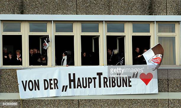 Supporters of StPauli watches from an old school building the Second Bundesliga match between FC St Pauli and SpVgg Greuther Fuerth at the Millerntor...