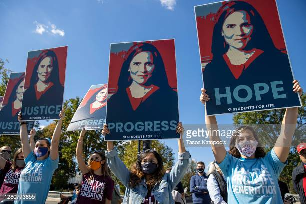 Supporters of Supreme Court nominee Judge Amy Coney Barrett show their support outside the Supreme Court on October 17, 2020 in Washington, DC....