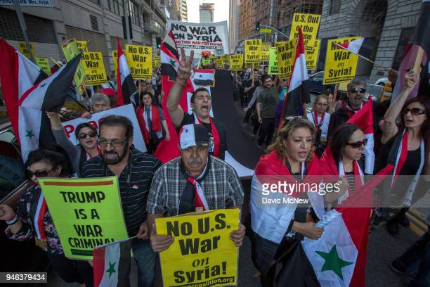 Supporters of Syrian president Bashar alAssad march in protest of the USled coalition attack in Syria on April 14 2018 in Los Angeles California Air...