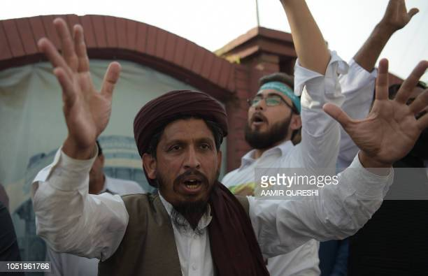 Supporters of TehreekeLabaik Pakistan a hardline religious political party chant slogans as they march during a protest in Rawalpindi on October 12...