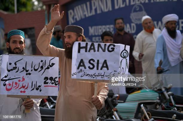 Supporters of TehreekeLabaik Pakistan a hardline religious political party hold placards as they chant slogans during a protest in Rawalpindi on...