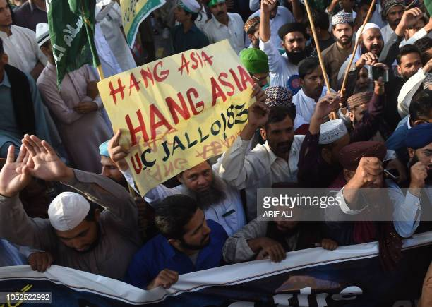 Supporters of TehreekeLabaik Ya Rasool Allah a hardline religious party march during a protest in Lahore on October 19 demanding for hanging to a...