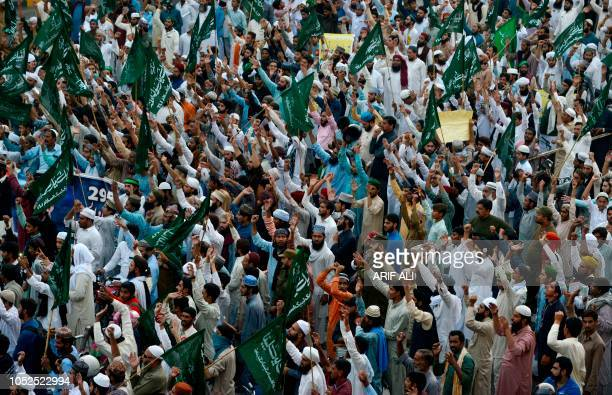 Supporters of TehreekeLabaik Ya Rasool Allah a hardline religious party chant slogans as they march during a protest in Lahore on October 19...