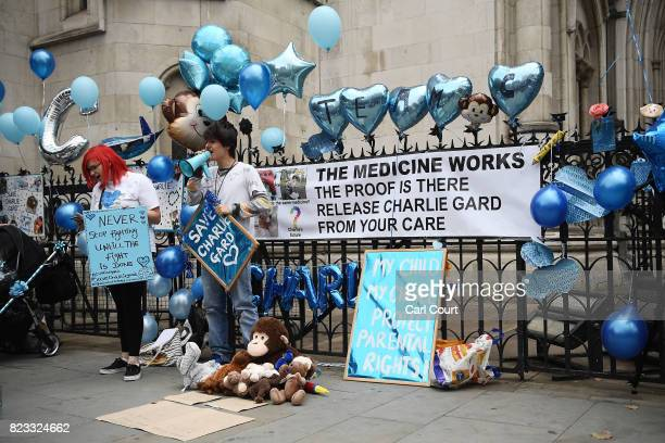 Supporters of terminally ill baby Charlie Gard protest outside the High Court as the verdict is announced on July 24 2017 in London England The...