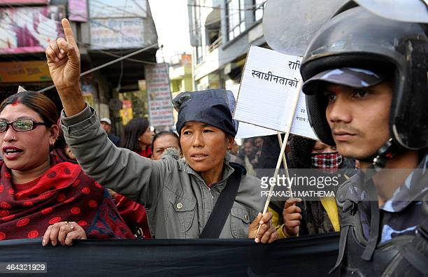 Supporters of the 33party alliance led by the Communist Party of NepalMaoist chant slogans as they demonstrate in front of the parliament building in...