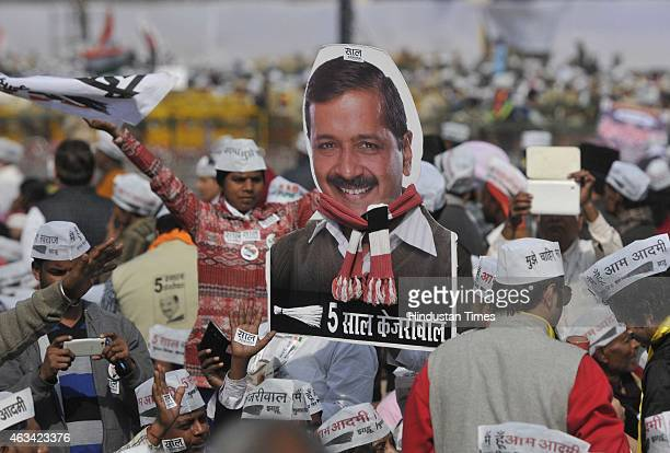 Supporters of the Aam Aadmi Party during the swearing-in ceremony of AAP leader Arvind Kejriwal at the Ramlila Ground on February 14, 2015 in New...