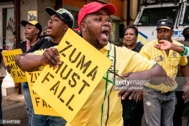 TOPSHOT Supporters of the African National Congress Deputy President Cyril Ramaphosa hold placards and chant slogans outside the ANC party...