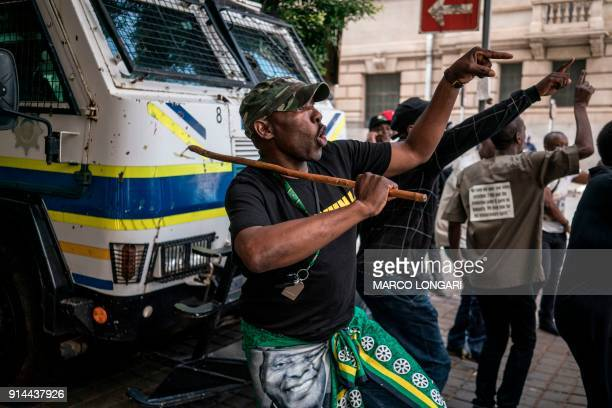 TOPSHOT Supporters of the African National Congress Deputy President Cyril Ramaphosa dance and chant slogans during a demonstration outside the ANC...