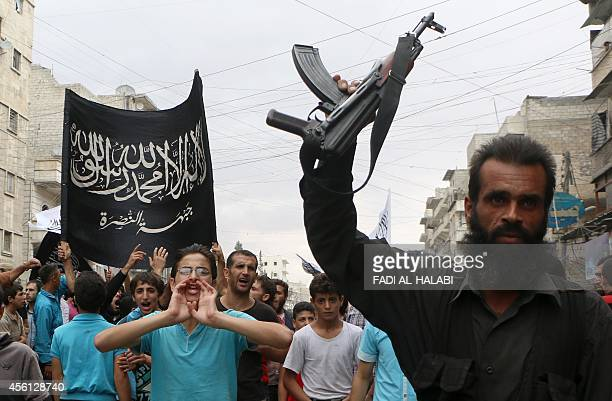 Supporters of the Al Nusra Front take part in a protest against Syrian President Bashar alAssad and the international coalition in Aleppo on...