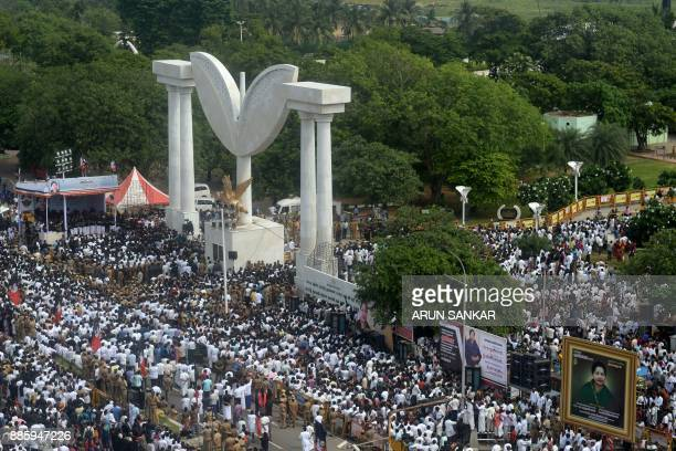 Supporters of the All India Anna Dravida Munnetra Kazhagam party take part in a procession at the memorial of former Tamil Nadu chief minister...