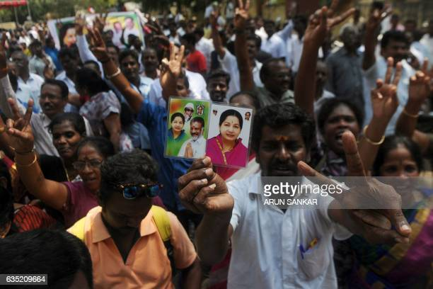 Supporters of the All India Anna Dravida Munnetra Kazhagham party celebrate in front of the residence of the acting chief minister O Panneerselvam of...