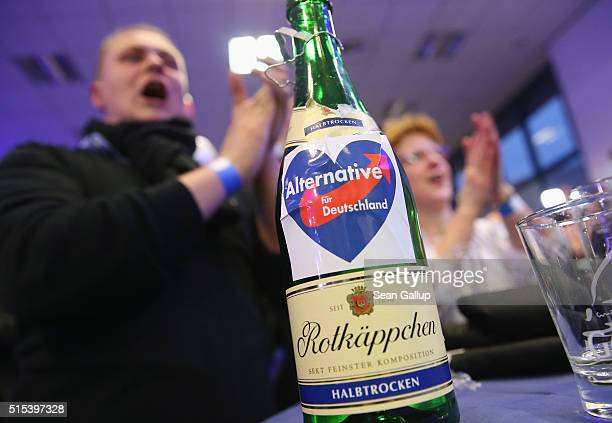 Supporters of the Alternative fuer Deutschland celebrate with champagne after strong initial exit poll results in SaxonyAnhalt state elections that...