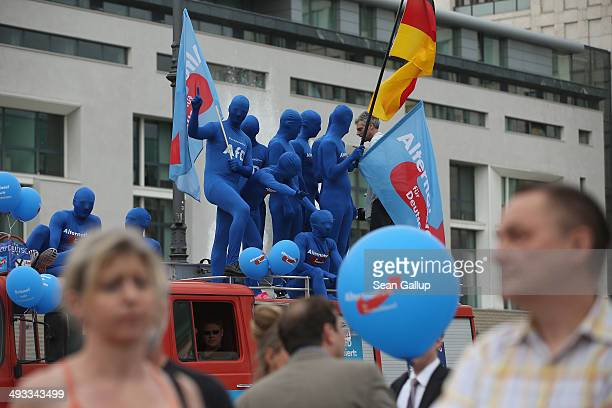 Supporters of the Alternative fuer Deutschland political party attend an election campaign rally ahead of European parliamentary elections on May 23...