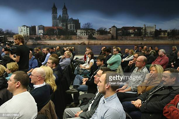 Supporters of the Alternative fuer Deutschland political party attend the concluding AfD election rally in the state of SaxonyAnhalt on March 11 2016...