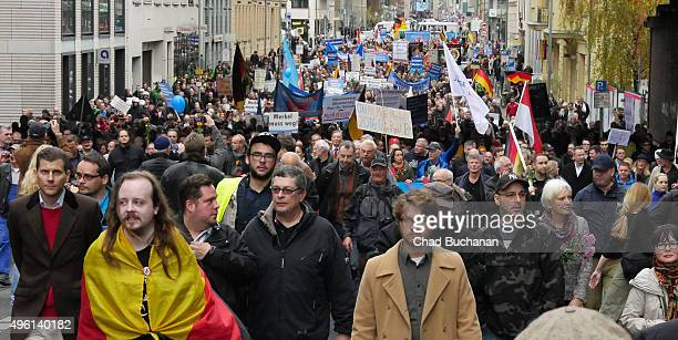 Supporters of the Alternative fuer Deutschland political party march together at a rally in the city center on November 6 2015 in Berlin Germany The...
