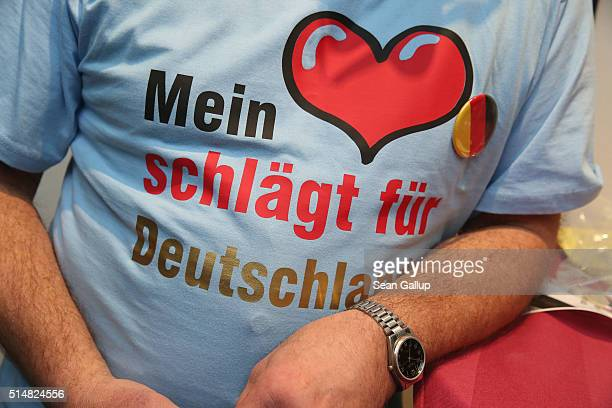 Supporters of the Alternative fuer Deutschland political party including one man wearing a tshirt that reads My heart beats for Germany attend the...
