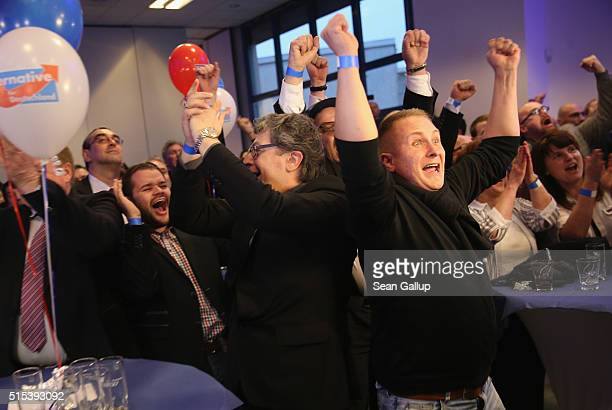 Supporters of the Alternative fuer Deutschland react to initial exit poll results in SaxonyAnhalt state elections that give the AfD a secondplace...