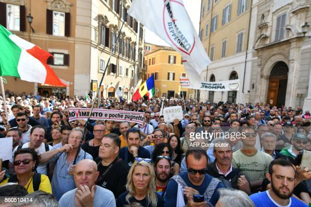 Supporters of the antiestablishment populist 5 Star Movement protest outside the lower house of parliament against the government's decision to put a...