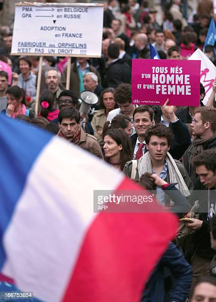 Supporters of the antigay marriage movement La Manif Pour Tous hold a French national flag as they demonstrate on April 16 2013 in Paris The final...