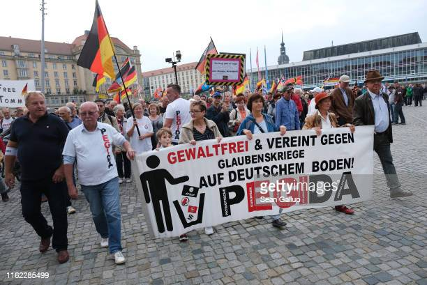 Supporters of the anti-Muslim Pegida movement march in their 187th weekly, Monday night gathering not far from the venue where German Chancellor...