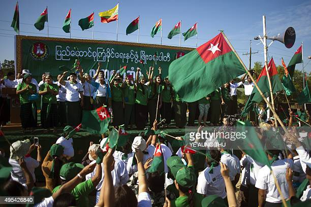 Supporters of the armybacked ruling Union Solidarity and Development Party dance to the party's song during a campaign rally in Mawbi outside of...