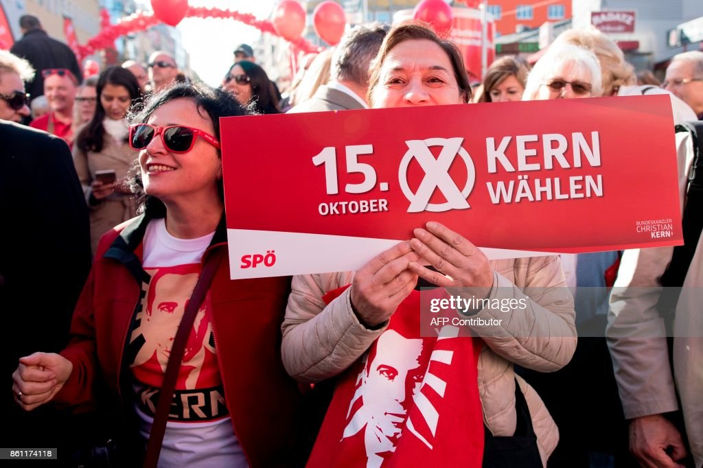 Supporters of the Austrian Chancellor and leader of the Social Democrats (SPOe) Christian Kern attend the party's last election rally on the eve of the Austrian parliamentary elections on October 14, 2017 in Vienna, Austria. Austria holds snap general elections on Sunday, October 15, 2017. /