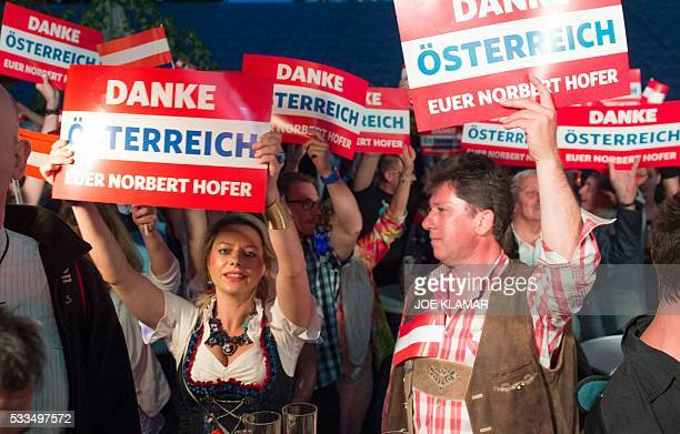 Supporters of the Austrian Freedom Party are pictured during the Austrian presidential elections runoff at the Prater Alm Bar in Vienna Austria on...
