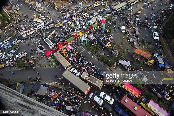 Supporters of the Bangladesh Awami League attend a mass rally in Dhaka on March 7 ahead of a planned Bangladesh Nationalist Party rally on March 12...