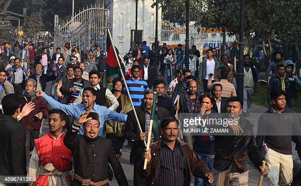 Supporters of the Bangladesh Awami League chase opposition supporters from the Bangladesh Nationalist Party during a protest in Dhaka on December 29...