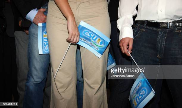 Supporters of the Bavarian Christian Social Union react to initial results at the Bavarian state parliament building after the closing of polling...