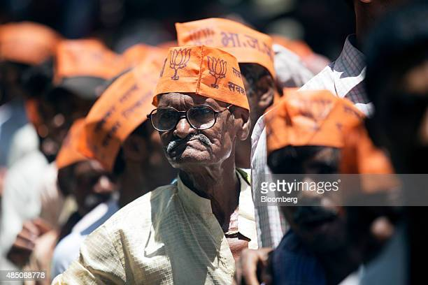 Supporters of the Bharatiya Janata Party stand in line to hear Indian Prime Minister Narendra Modi speaks at a rally in Muzaffarpur Bihar India on...